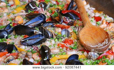 Paella Rice With Clams And Mussels And Green Peas