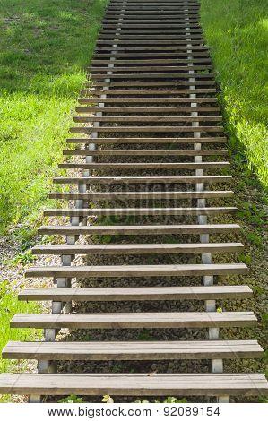 Wooden Plank Vanishing Ladder In Summer Park
