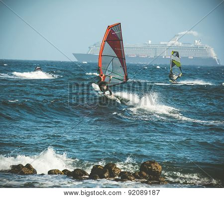 windsurfing and liner on backgroung