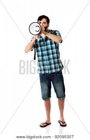 Young man yelling into megaphone.
