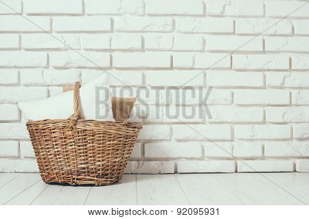 Wicker basket with a pillow