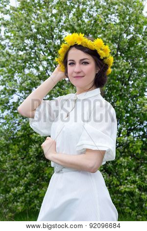 Beautiful Woman In White Vintage Dress With Flower Wreath On Head
