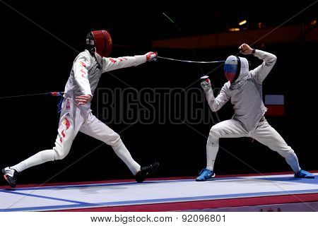 ST. PETERSBURG, RUSSIA - MAY 3, 2015: Alexey Cheremisinov of Russia vs Sheng Lei of China in the team final match of 41th International fencing tournament St. Petersburg Foil, the stage of World Cup
