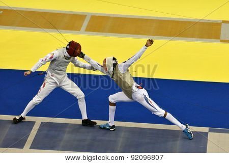 ST. PETERSBURG, RUSSIA - MAY 3, 2015: Team semifinal match China vs France during 41th International fencing tournament St. Petersburg Foil. The tournament is the stage of FIE World Cup