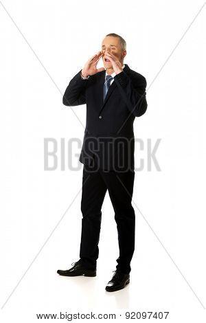 Full length businessman calling for someone.