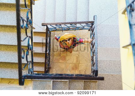 Woman Watching From Below Three Story Staircase