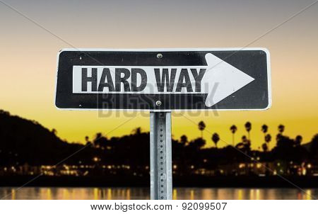 Hard Way direction sign with sunset background
