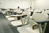 stock photo of midterm  - view of a classroom seating area with rows of chairs - JPG
