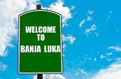 image of luka  - Green road sign with greeting message WELCOME TO BANJA LUKA isolated over clear blue sky background with available copy space - JPG