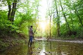 stock photo of fly rod  - Fisherman with fly - JPG