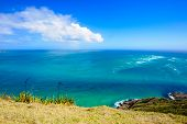 stock photo of pacific islands  - Cape Reinga the meeting point of the Tasman Sea and the Pacific Ocean in the Northland North Island of New Zealand - JPG