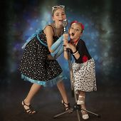 pic of rockabilly  - Rockabilly girls singing and posing with vintage microphone in 1950 - JPG
