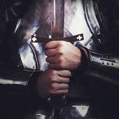 stock photo of longsword  - knight wearing armor and holding two - JPG