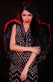 picture of hells angels  - Beautiful young woman with black angel wings over dark red background - JPG