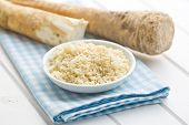 picture of grated radish  - grated horseradish root on kitchen table - JPG