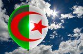 pic of algeria  - balloon in colors of algeria flag flying on blue sky  - JPG