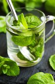 pic of mints  - Mint Tea in glass cup and fresh mint leaves - JPG