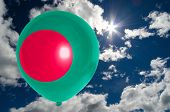 foto of bangladesh  - balloon in colors of bangladesh flag flying on blue sky