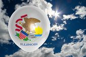 foto of illinois  - balloon in colors of illinois flag flying on blue sky  - JPG