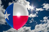 picture of texans  - balloon in colors of texas flag flying on blue sky  - JPG