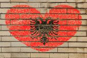 picture of albania  - heart shaped flag in colors of albania on brick wall - JPG