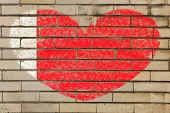 foto of bahrain  - heart shaped flag in colors of bahrain on brick wall - JPG