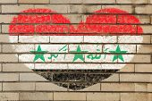 pic of iraq  - heart shaped flag in colors of Iraq on brick wall - JPG