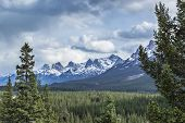 stock photo of snow capped mountains  - A view of the Bow Valley and snow capped mountains on a stormy day in Banff National Park Alberta Canada  - JPG