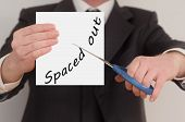 foto of space suit  - Spaced out man in suit cutting text on paper with scissors - JPG
