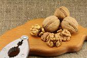 picture of nutcracker  - Walnuts on a wooden board  - JPG