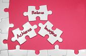 picture of achievement  - Achieve Believe Imagine word on white puzzle  - JPG