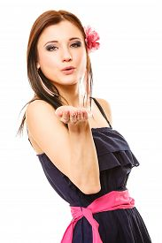 stock photo of flirty  - Portrait of beautiful girl in summer style blowing a kiss isolated on white background - JPG