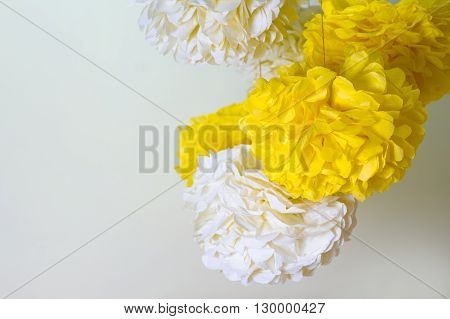 yellow and white paper pompons and a place for text.