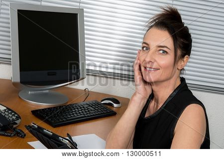 a nice Business woman at work with computer