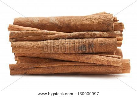 Raw Organic Cinnamon sticks (Cinnamomum verum) isolated on white background. Macro closeup Front view.