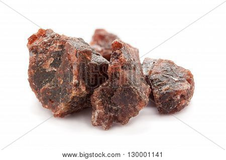 Raw Organic Himalayan Black Salt or Kala namak isolated on white background. Macro closeup Front view.