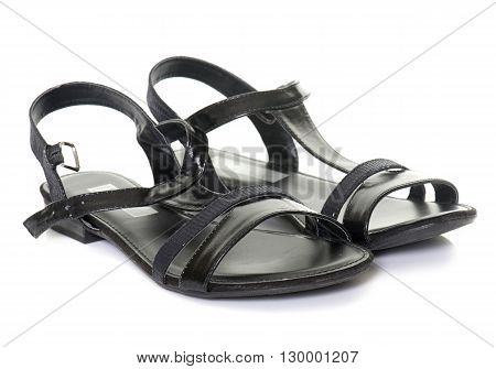 black sandals in front of white background