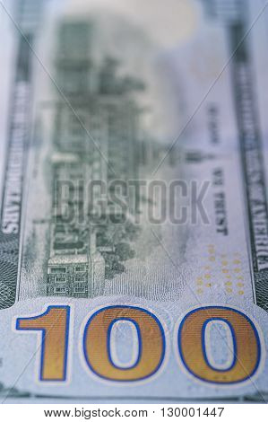 Closeup of one hundred dollar bill, vertical view