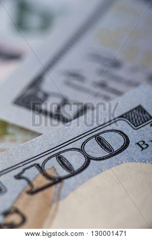 One hundred dollar bill, macro. Vertical view.