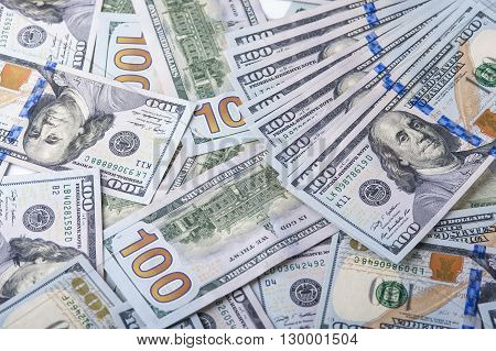 Heap of one hundred dollar bills one hundred dollar bills background.