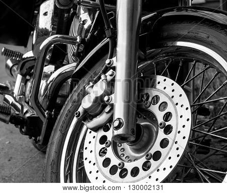 Motorcycle staying outdoor in black and white. Bike concept