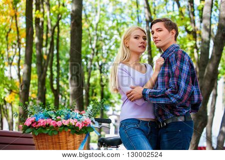 Young couple kissing and huging in summer park. First date of loving couple.