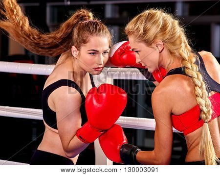 Two  women boxer wearing red  gloves to box in ring. Two  men boxer wearing helmet and  gloves boxing. Boxing is  extreme sport.