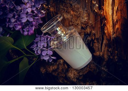 Perfume Bottle With A Sprig Of Lilac