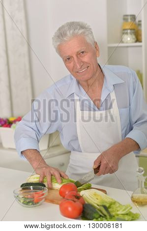 Portrait of  senior man  in the kitchen at home