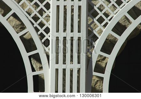 a picture of an exterior building white wood gazebo