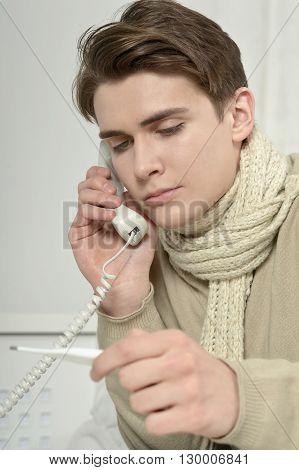 portrait of sick man  calling his doctor