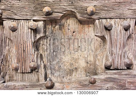 part or fragment closeup of old and ancient wooden doors or gate for the abstract textured vintage background