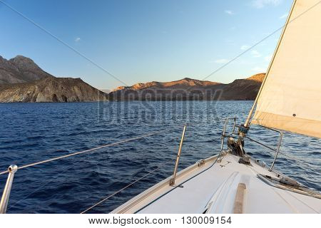View from a sailboat on the shore in the evening