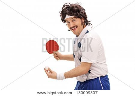 Young retro man playing table tennis and looking at the camera isolated on white background